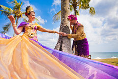 Mature couple dressed in Balinese costume Stock Photo