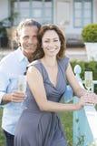 Mature couple on vinyard balcony. Royalty Free Stock Photography