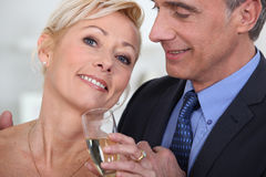 Mature couple drinking champagne Stock Image