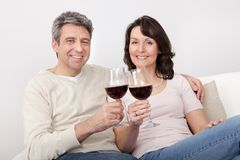Mature couple drinking red wine Stock Photo