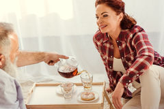 Mature couple drinking tea Royalty Free Stock Photography