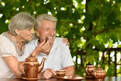 Mature couple drinking tea outside Stock Photo