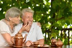 Mature couple drinking tea outside Stock Photo