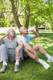 Mature couple drinking water at park Stock Photo