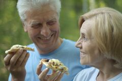 Mature couple eat pizza Stock Photo