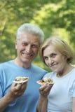 Mature couple eat pizza Stock Image