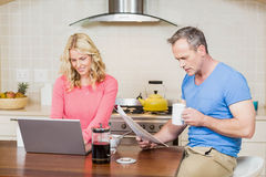 Mature couple eating breakfast Stock Photography
