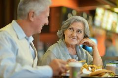 Mature couple eating french fries Royalty Free Stock Photography