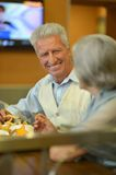 Mature couple eating french fries Stock Photography