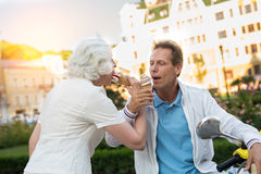 Mature couple eating ice cream. Royalty Free Stock Photography