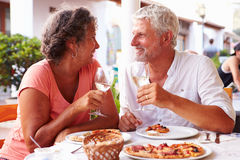 Mature Couple Eating Meal Outdoors Together Royalty Free Stock Photo