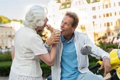 Mature couple eats ice cream. Stock Photos