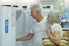 Mature couple at electronics shop Stock Photo