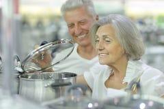 Mature couple at electronics shop Royalty Free Stock Photos
