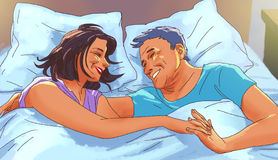 Mature couple is embracing in bed Royalty Free Stock Image