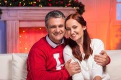 Mature couple embracing on christmas Stock Photography