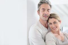 Mature couple embracing indoors Royalty Free Stock Photos
