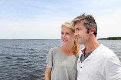 Mature couple embracing by the lake Royalty Free Stock Photo