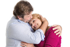 Mature couple embracing - man and woman isolated on white backgr Royalty Free Stock Image