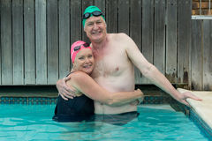 Mature couple embracing in swimming pool Royalty Free Stock Photo