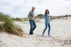 Mature couple enjoying on beach royalty free stock photo