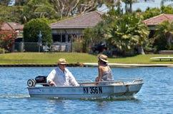 Mature couple enjoying a boat ride Stock Image