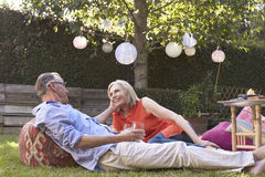 Mature Couple Enjoying Drinks In Backyard Together Royalty Free Stock Photos