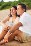 Mature Couple Enjoying Sunset on the Beach Royalty Free Stock Photos