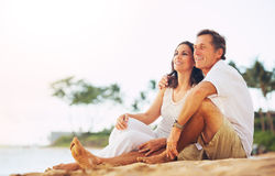 Mature Couple Enjoying Sunset on the Beach stock photography