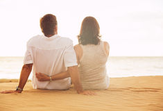 Mature Couple Enjoying Sunset on the Beach Stock Image
