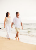 Mature Couple Enjoying Sunset on the Beach Royalty Free Stock Images