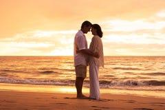 Mature Couple Enjoying Sunset on the Beach Royalty Free Stock Photos