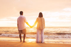 Mature Couple Enjoying Sunset Royalty Free Stock Photos