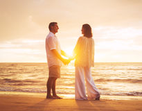 Mature Couple Enjoying Sunset Stock Images