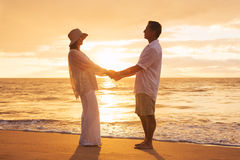 Mature Couple Enjoying Sunset Royalty Free Stock Photography
