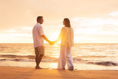 Mature Couple Enjoying Sunset Stock Photography