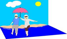 Mature Couple Enjoying The Sun And Water.. Royalty Free Stock Images