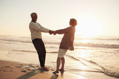 Mature couple enjoying themselves on the beach Stock Images