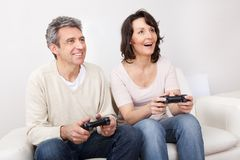 Mature couple enjoying videogames Stock Image