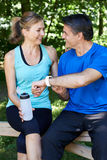 Mature Couple Exercising In Countryside Together Stock Photos