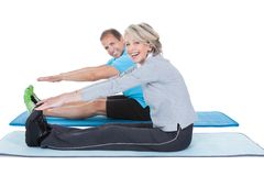Mature couple exercising Stock Images