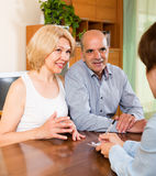 Mature couple filling questionnaire Stock Photography