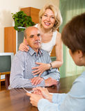 Mature couple filling questionnaire Royalty Free Stock Images