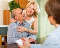 Mature couple filling questionnaire Stock Photos