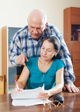 Mature couple fills in questionnaire Royalty Free Stock Image