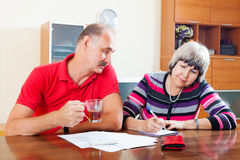 Mature couple fills in questionnaire together Stock Image