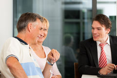 Mature couple with financial consultant Stock Photo