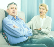 Mature couple find out relationship. And sort out family problems in home interior royalty free stock image