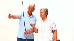 Mature couple fishing Royalty Free Stock Images