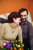 Mature Couple With Flowers Royalty Free Stock Photos